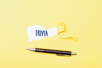 Trivia word behind ripped piece of paper