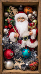 Santa Claus doll in a wooden box with Christmas decoration