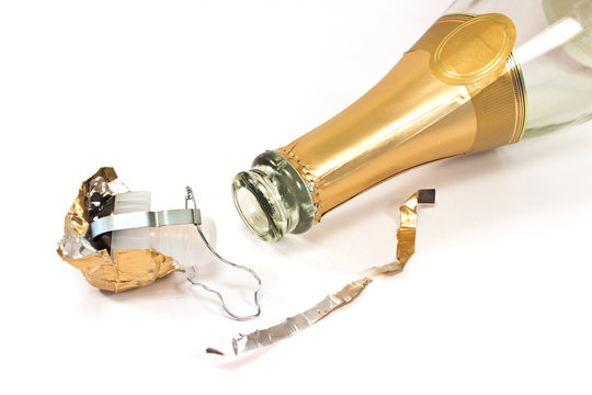 Empty champagne bottle with cork on white background