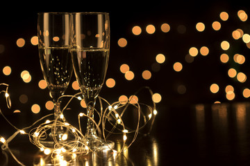 New Year toast champagne led lights,  bokeh lights background