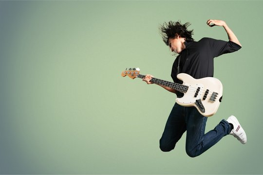 Portrait of a Musician Jumping while Playing