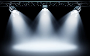 Bright stage spotlights shining on dark background. 3d rendering