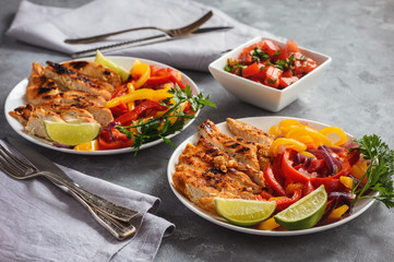 Grilled chicken fillet with sauteed peppers and onion.