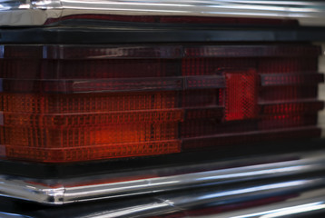 fragment of the backlight of a black vintage luxury car