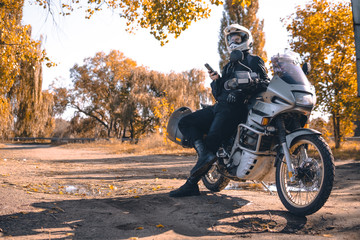 Motorbiker travelling, autumn day, motorcycle off road, rider, adventurer, extreme tourism, cold...