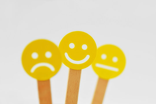 Yellow smiley faces with positive, neutral and negative expression - Positivity concept