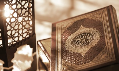 Islamic Book Koran with rosary on grey Wall mural