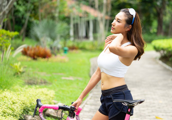 Portrait of young sport lady with pink bicycle resting after exercise