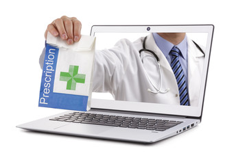 Internet drug store pharmacy concept doctor holding prescription medicine through a laptop screen