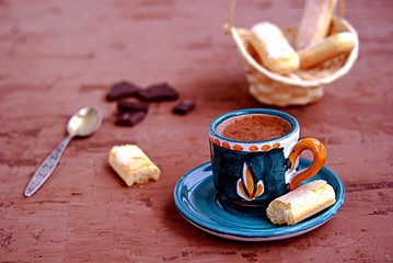 Dessert, Sicilian hot chocolate in a coffee cup on a dark brown background. Served with biscuit cookies.