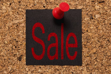 Mural message. Reminder of Black Friday. Red thumbtack. Text: Sale