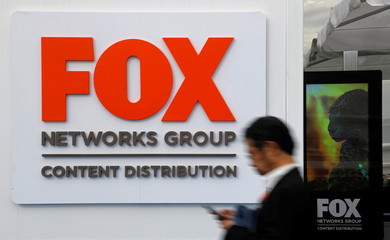 A man walks past the logo of Fox Networks Group during the annual MIPCOM television programme market in Cannes