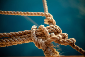 rope with knot on wooden background
