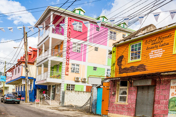 Picture of a typical street of houses on the carrebbian island of Dominica