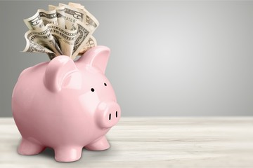 Piggy bank and  money on background