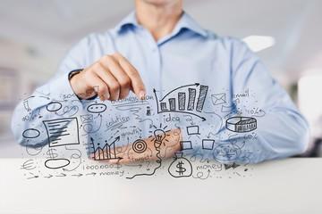 Businessman and  analytics symbols on  background
