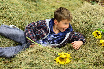 Just relax. Little child relax in hayloft. Little child lying in hayloft in countryside. A wonderful way to relax