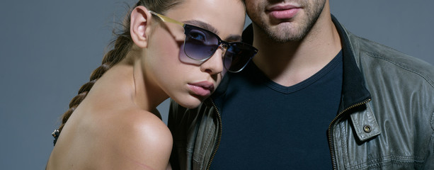 Protect your eyesight. Fashion models in trendy sun glasses. Couple in love. Couple of man and woman wear fashion glasses. Love relations. Friendship day. Friendship relations