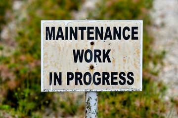 Maintenance work in progress sign board