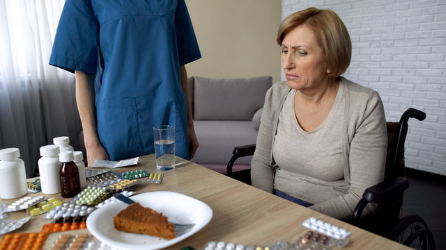 Depressed elderly lady have bad appetite, having poor health, nursing service