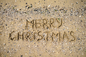 Merry Christmas written on tropical beach sand, copy space. Holiday concept