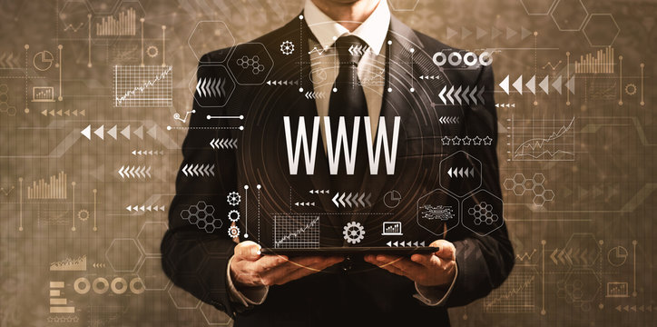 www with businessman holding a tablet computer on a dark vintage background