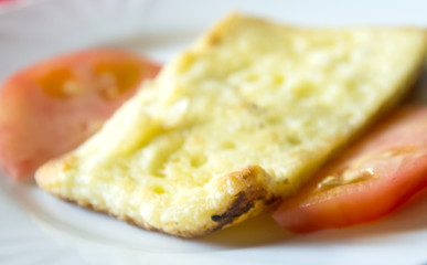 roasted sheep cheese and tomato slices in a plate,shallow dof