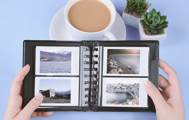 Photo album with instant photos of landscapes