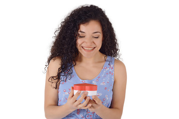 Portrait of an excited cute woman opening present box