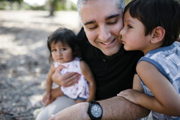 Close-up of father with children at park