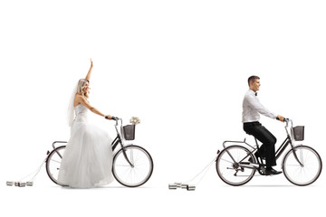 Bride and a groom riding bicycles