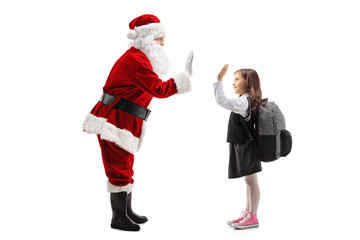 Santa Claus high-fiving a schoolgirl