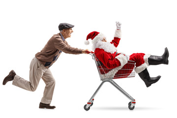 Senior pushing a shopping cart with Santa Claus