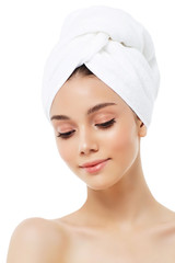 Beautiful woman in a white towel on a head
