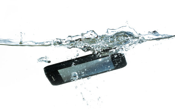 smartphone is falling into the water with splash, concept for waterproof product or insurance claim, isolated on a white background, copy space