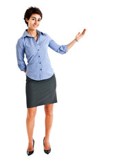 Business woman with her arm out in a welcoming or presenting gesture, isolated on white background