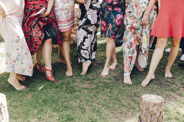 Row of female guests of a wedding showing her legs