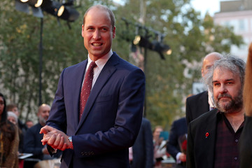 "Britain's Prince William, Duke of Cambridge (L) and New Zealand film maker Peter Jackson (R) attend the world premiere of Peter Jackson's film ""They Shall Not Grow Old"" during the BFI London Film Festival in London"