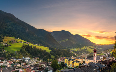 Sunset over Ortisei St Ulrich, Dolomites Alps mountains, Italy. Wall mural