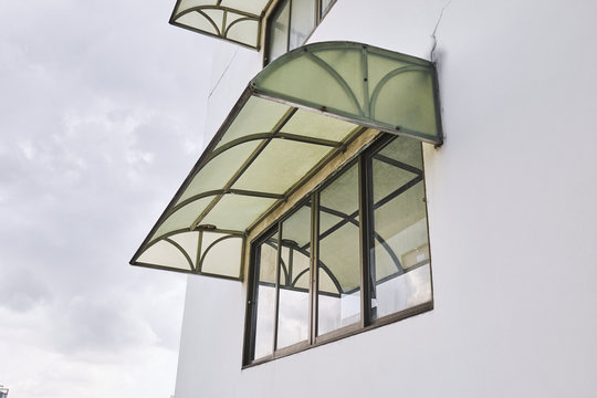 Old green awning mounted outside the building cover the windows