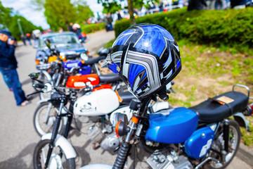 Blue helmet hangs on a german motorbike