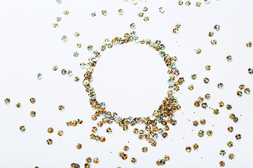 Round colorful sequins on white background