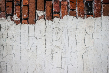 the texture of an old brickwork with fragments of white plaster