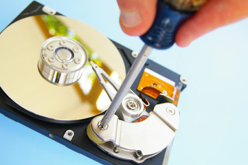 Technician working on a computer hard drive