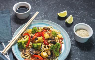 Asian tofu soba noodle bowl on stone background