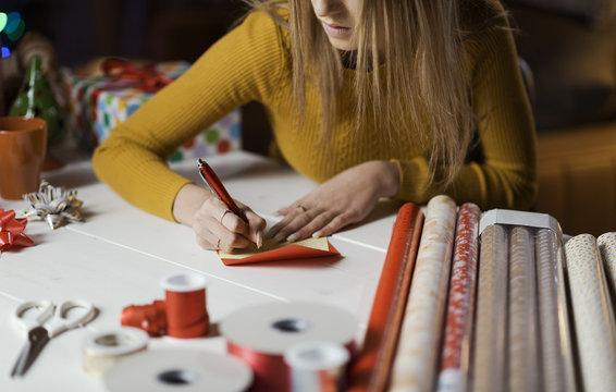 Woman writing a Christmas card