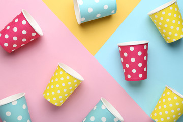 Paper cups on colorful background
