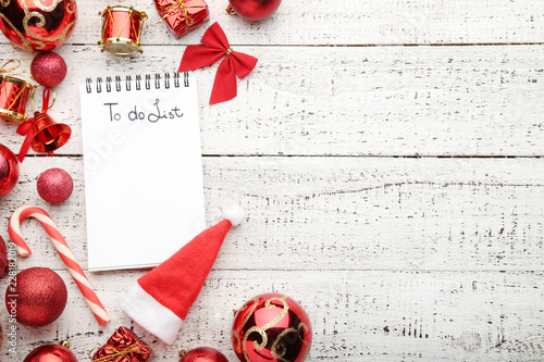 """""""To do list in notepad with christmas decorations on wooden table"""" Stock photo and royalty-free images on Fotolia.com - Pic 216025523"""