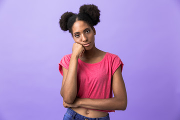 Photo of displeased african american woman propping up head, isolated over violet background