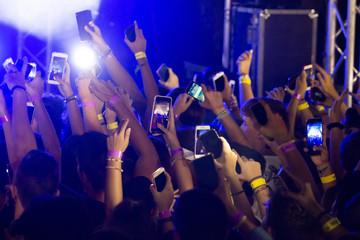 fans holding cellphones